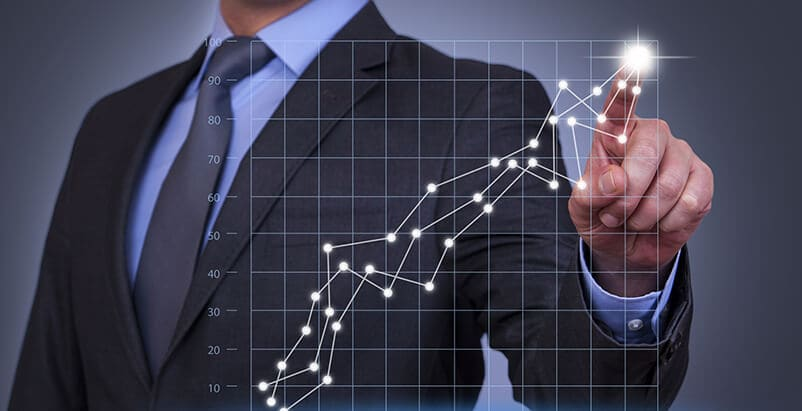 Person touching a virtual line graph chart