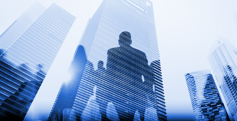 Skyscraper buildings with silhouettes of people shaded on them
