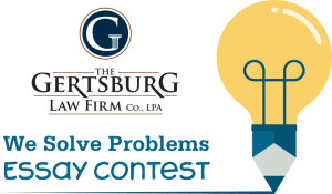 """Gertsburg Law Firm logo, text saying """"we solve problems essay contest"""" with an illustration of the combination of a lightbulb and a pencil"""