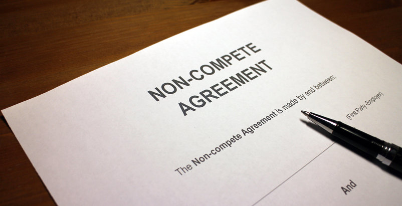 Non-compete Agreement paper and pen on a table