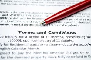 Pen on a paper with terms and conditions