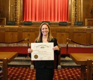 Cindy Menta sworn in as attorney and holding a certificate